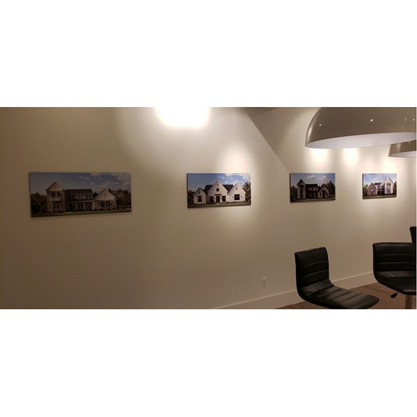 Toll Brothers wanted a simple yet dimensional display to show off their new homes currently in development. Printed photos on PVC, mounted to the wall is how this was presented.