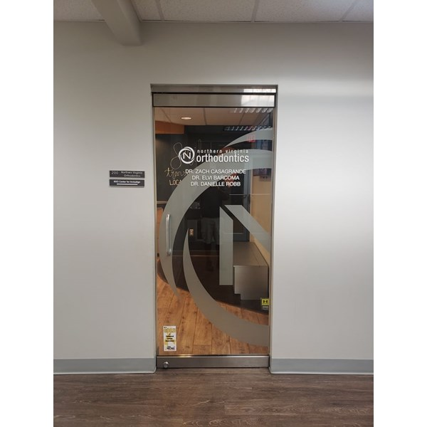Northern Virginia Orthodontics needed a doctors name removed from their door, and some etched vinyl of their logo added.
