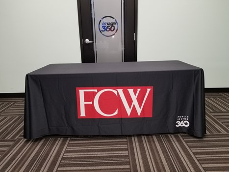 Public Sector 360 needed a simple yet elegant table throw with their logos printed. This is the 6ft size and its made from a smooth washable fabric.